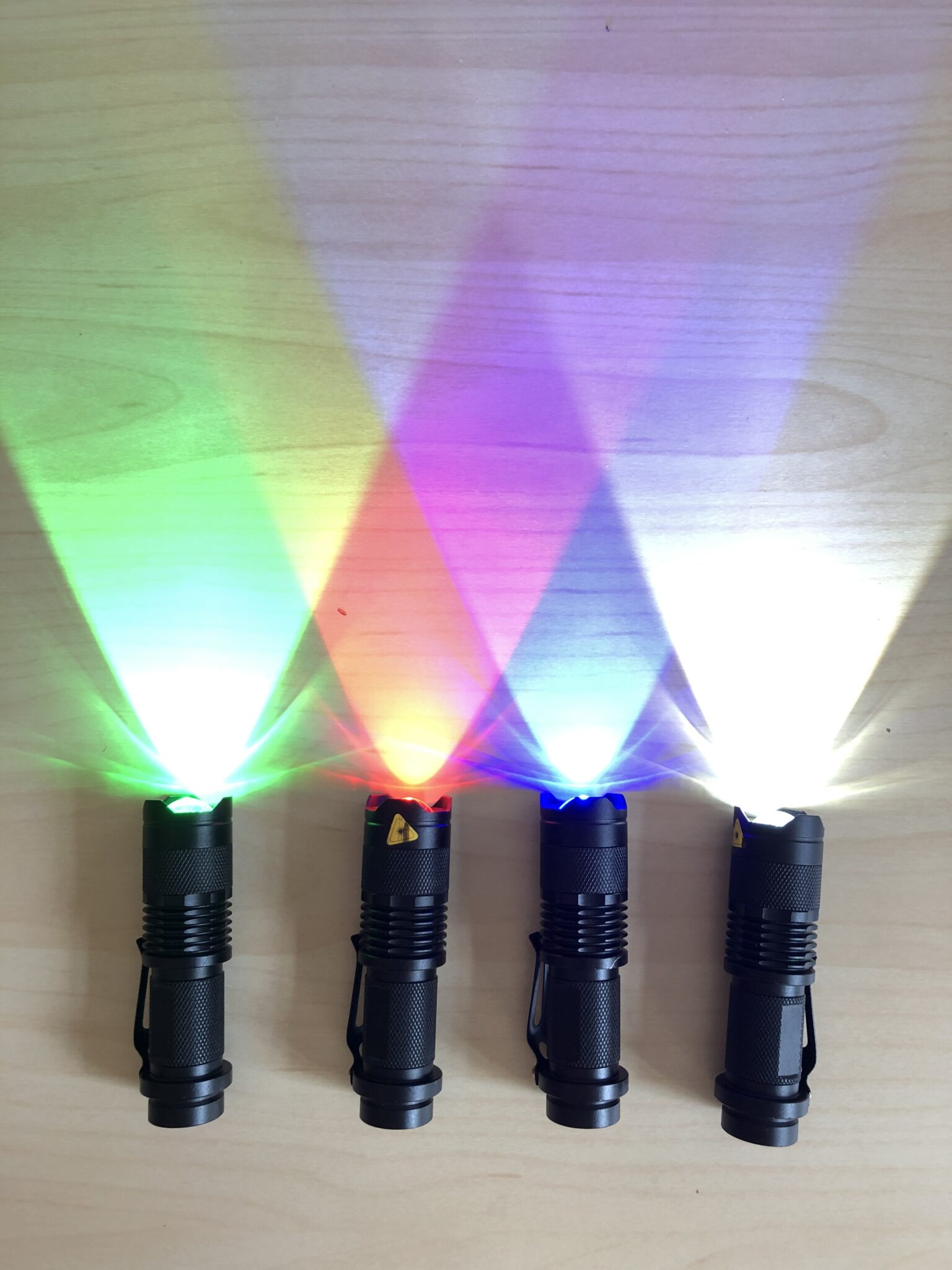 a series of colorful flashlights with their lights turned on
